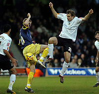 Photo: Kevin Poolman.<br />Luton Town v Derby County. Coca Cola Championship. 18/11/2006. Markus Heikkinen (right) of Luton and Jonathan Stead of Derby both go in for the ball.