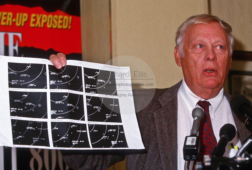 Journalist Mike Sommer shows radar track evidence during a press conference on the conspiracy behind the crash of TWA Flight 800 in Washington, DC.