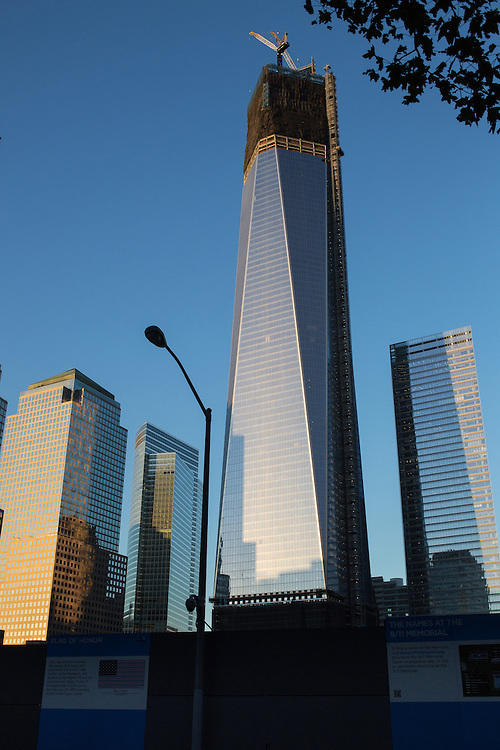 Freedom Tower at 1 World Trade Center seen from the south side of the World Trade Center Memorial. The new building stands in stark contrast to the mess on the streets below.