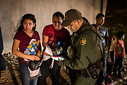 Thirteen-year-old Joseline, a Guatemalan migrant seeking asylum with father Jose Luis, cries after crossing the Rio Grande and turning herself in to U.S. Border Patrol in Hidalgo, Texas, U.S., August 23, 2019.