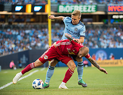 July 8, 2018 - Bronx, New York, United States - New York Red Bulls midfielder DANIEL ROYER (77) fights to maintain the ball against New York City defender ANTON TINNERHOLM (3) during a regular season match at Yankee Stadium in Bronx, NY.  New York City FC defeats the New York Red Bulls 1 to 0 (Credit Image: © Mark Smith via ZUMA Wire)
