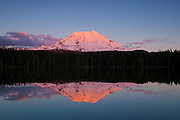 Mount Adams, one of five volcanoes in Washington state, is reflected in the relatively still waters of Takhlakh Lake in the Gifford Pinchot National Forest. Mount Adams, at 12276 ft. (3742 m), is the second-tallest mountain in the state.