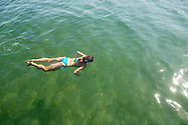 Olga, 43, on vacation from Mariupol, swims in the Black Sea in Odessa, Ukraine.<br /> <br /> (September 2016)