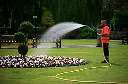 UNITED KINGDOM HAMPSHIRE 17JUN09 - Gardener hoses flower bed in a park in WInchester, with water fed from the chalkstream river Itchen in Winchester in Hampshire, southern England...jre/Photo by Jiri Rezac / WWF UK..© Jiri Rezac 2009