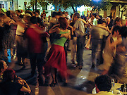 """Men and women dance tango at a free public dance held on Sundays in Dorrego Square, in San Telmo (""""Saint Pedro González Telmo""""), the oldest historic neighborhood (barrio) in Buenos Aires, in Argentina, South America."""