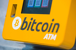 File photo dated 16/10/15 of a Bitcoin ATM, as the cryptocurrency went into freefall on Friday, with its price collapsing from nearly 20,000 US dollars earlier this week to around 12,000 US dollars as steam appeared to be running out of its year-end rally.