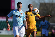 Exeter's Danny Coles (l) holds off Newport's Chris Zebroski. Skybet football league two match, Newport county v Exeter city at Rodney Parade in Newport, South Wales on Sunday 16th March 2014.<br /> pic by Andrew Orchard, Andrew Orchard sports photography.