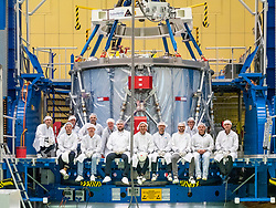 November 1, 2018 - Brevard, Florida, U.S. - The Airbus team poses with the European Service Module during preparations for shipment to NASA's Kennedy Space Center. The module is scheduled to depart Germany on November 5, arriving at Kennedy on November 6. For the first time, NASA will use a European-built system as a critical element to power an American spacecraft, extending the international cooperation of the International Space Station into deep space. (Credit Image: ? NASA/ZUMA Wire/ZUMAPRESS.com)