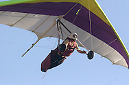 Ellenville, NY - A man flying a hang glider  soars in the sky above Ellenville on May 30, 2009.