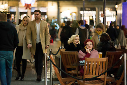 © Licensed to London News Pictures.15/12/2020. London, UK. Londoners are seen enjoying their last night of drinking in Covent Garden, before London will go into Tier 3 on Wednesday. Photo credit: Marcin Nowak/LNP