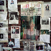 During a journey into America's hinterlands, days after the September 11th attacks in New York and Washington DC, the streets between 66th and 67th Streets, in the heart of Manhattan's Upper East Side, was a point of focus for those with missing relatives who attached thousands of posters to walls with pictures and messages to loved-ones in the hope of being reunited. DNA samples were taken at the nearby Armory so human remains might be identified. Here, the coloured ink from desktop printers prints have streaked after rain soaked the posters leaving a sense of the tragic disappearance of thousands - a haunting detail of the missing and the dead. Emotions were therefore running high and we see the sad, rain-soaked messages, the faces of happy people and their physical descriptions and contacts numbers. In most cases, these people were never seen again.