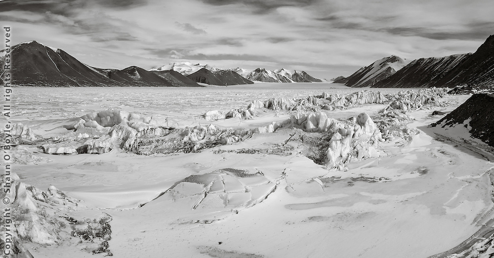 Pressure ridges and Ferrar Glacier in distance. During the Discovery Expedition in 1903 this is the glacier Captain Scott, Evans and Lashley journeyed up to the Polar Plateau during the western journey.