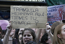 April 26, 2018 - Madrid, Espagne - A protester carries a sign that says ''Calm sister here is your pack'' in the demonstration in protest against the sentence to the trial for violation of the ''Pack' (Credit Image: © Panoramic via ZUMA Press)