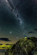 Mild geomagnetic activity from the Aurora Australis simmers on in the early morning hours of 23rd April 2017, while the tail end of the Milky Way descends upon the peak of the cliffside.  Catlins, New Zealand.