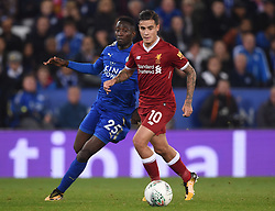 Leicester City's Wilfred Ndidi (left) and Liverpool's Philippe Coutinho battle for the ball