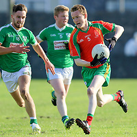 O'Curry's-Naomh Eoin's Seamus Keane is chased by Kilrush Shamrock's Mark Fennell