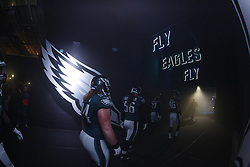 """Philadelphia Eagles linebacker Bryan Braman #56 and teammates walk through the tunnel from the Eagles Locker room to the field with """"Fly Eagles Fly"""" and Eagles wings seen before the NFL Game between the Tampa Bay Buccaneers and the Philadelphia Eagles at Lincoln Financial Field in Philadelphia, PA on Sunday, November 22nd 2015. The Buccaneers won 45-17. (Brian Garfinkel/Philadelphia Eagles)"""