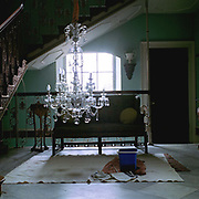 Washing the chandelier during the annual spring clean in the hallway of Newby Hall stately home, Newby Hall estate and gardens, Ripon, North Yorkshire, UK