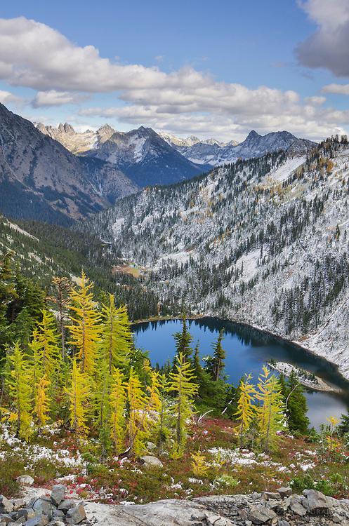 Lake Ann and golden larches after autumn snowfall. North Cascades Washington