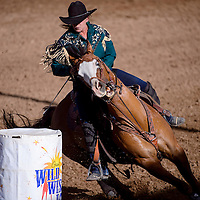 070214       Cable Hoover<br /> <br /> Barrel racer Anita Mills rounds her first barrel in the Senior Pro Rodeo at the Grants Rodeo Grounds Wednesday.