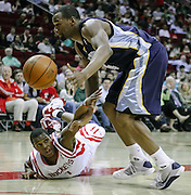 March 17, 2010; Houston, TX, USA; Houston Rockets guard Kyle Lowry (7) falls while defending Memphis Grizzlies guard Sam Young (4) in the second quarter at the Toyota Center. Mandatory Credit: Thomas Campbell-US PRESSWIRE