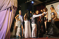Contestants are awarded prizes by hosts and judges on stage at The Mekan, hosting Istanbul's second trans beauty contest.
