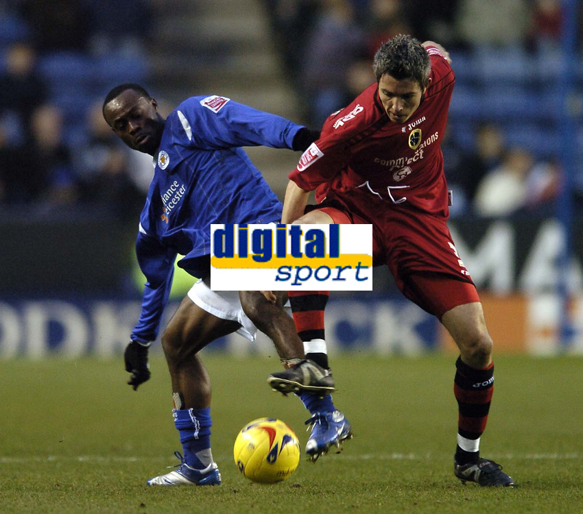 Photo: Jonathan Butler.<br />Leicester City v Cardiff City. Coca Cola Championship. 23/12/2006.<br />Kevin McNaughton of Cardiff holds off Elvis Hammond of Leicester.