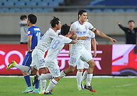 Giovanni Moreno of Shanghai Shenhua, right, celebrates with teammates after scoring a goal against Jiangsu Sainty during their 28th round match of the 2014 Chinese Football Association Super League in Nanjing city, east China's Jiangsu province, 18 October 2014.<br /> <br /> Jiangsu Sainty drew with Shanghai Shenhua 1-1.