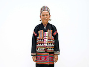 Se Su 60 an ethnic Lahu woman from Laos at Baan Tong Luang, Eco-Agricultural Hill Tribes Village on 7th June 2016 in Chiang Mai province, Thailand. The fabricated village is home to 8 different hill tribes who make a living from selling their handicrafts and having their photos taken by tourists