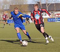 Fotball herrer 2. divisjon avd. 2 Strindheim - Hødd 6-2<br /> Eirik Breen, Strindheim og Vegard Holand, Hødd<br /> Foto: Carl-Erik Eriksson, Digitalsport