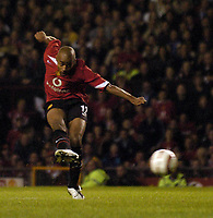 Photo. Jed Wee.<br /> Manchester United v Dinamo Bucharest, UEFA Champions League Qualifying 2nd Leg, 24/08/2004.<br /> Manchester United's David Bellion fires in United's third goal