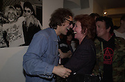 Mick Rock and Cilla Black. ( Nicky Haslam ) Mick Rock exhibition opening at the Proud Gallery and after party at the Mayfair Club. London. 4 April 2001. © Copyright Photograph by Dafydd Jones 66 Stockwell Park Rd. London SW9 0DA Tel 020 7733 0108 www.dafjones.com