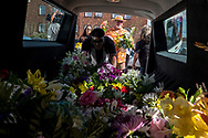 People load flowers into hearses at the La Paz Faith Memorial & Spiritual Center to be delivered to the memorial for the victims of the Aug. 3 mass shooting in El Paso, Texas, Sunday, August 18, 2019.