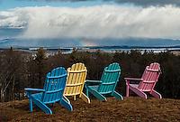 Rainbow colored chairs over looking Lake Winnipesaukee.   Karen Bobotas Photographer