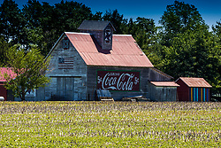 Barn<br /> <br /> Rugged Barn near Towanda Illinois sports a Coca Cola advertisement, barn quilt and a painting of the American Flag