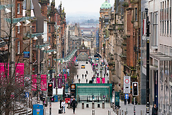 Glasgow, Scotland, UK. 26 March, 2020. Views from city centre in Glasgow on Thursday during the third day of the Government sanctioned Covid-19 lockdown. The city is largely deserted. Only food and convenience stores open. Pictured; A view long normally busy Buchanan Street which today is almost empty. Iain Masterton/Alamy Live News