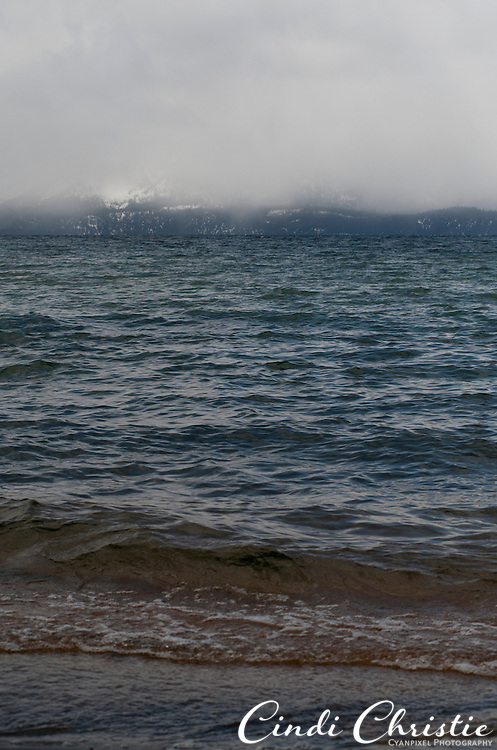 Snow falls down to Lake Tahoe's waterline as seen from Zephyr Cove, Nev., on Sunday, April 24, 2011.  (© 2011, Cindi Christie/Cyanpixel® Photography)