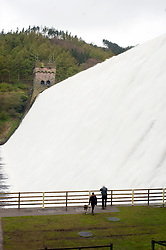 Derwent Dam in the Peak National Park overflows as parts of of Britain still have a hosepipe ban in place despite the possibility that April 2012 could be the wettest in 250 years..27 April 2012 .Image © Paul David Drabble