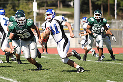 15 September 2007: Charlie Welke shadows Mike Lovell to cut off his run.  The Titans stood toe to toe with the 25th ranked Lions through the first half but ended the game on the losing end of a 25-15 score at Wilder Field on the campus of Illinois Wesleyan University in Bloomington Illinois.