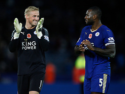 Kasper Schmeichel (L) and Wes Morgan of Leicester City applaud the fans at the final whistle  - Mandatory byline: Jack Phillips/JMP - 07966386802 - 7/11/2015 - SPORT - FOOTBALL - Leicester - King Power Stadium - Leicester City v Watford - Barclays Premier League