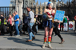 March 29, 2019 - London, England, UK - An anti-Brexit protester dressed as Wonder Woman outside Parliament. British MPs will vote on whether to accept Prime Minister Theresa May's withdrawal agreement for a third time today. (Credit Image: © Rob Pinney/London News Pictures via ZUMA Wire)