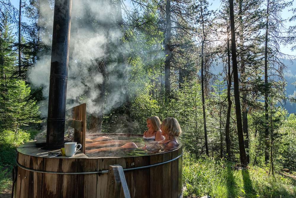 Women soaking in a wood-fired hot tub at the Minam River Lodge, Oregon.