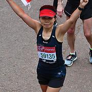 London, England, UK. 28 April 2019. Hunglei Huan from China finish the Virgin Money London Marathon at Pall Mall.