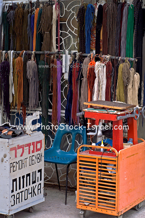 Shoemaker stall, Tel Aviv Israel text in Hebrew and Russian