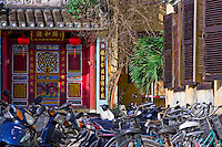 colourful entrance to small temple near Hoi An's waterfront.