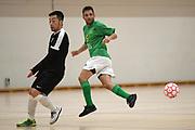 Central player Kenny Santy and Capital player Shingo Ina in the Mens Futsal Superleague match, Central v Capital, Pettigrew Green Arena, Napier, Saturday, September 28, 2019. Copyright photo: Kerry Marshall / www.photosport.nz