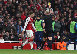 Arsenal's Granit Xhaka is shown a yellow card during the Premier League match at the Emirates Stadium, London.