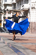 Plaza de Cagancha Square, a couple man and woman dancing flamenco and tango on a city square, dressed in blue skirt black top, white pants, blue shirt and black hat. woman lifting and swirling her skirt. Montevideo, Uruguay, South America