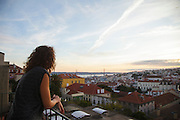 """Cristina Gaudencio, the manager of hotel """"Casa das Janelas com Vista"""" looks at the view in one of the room's balconies."""