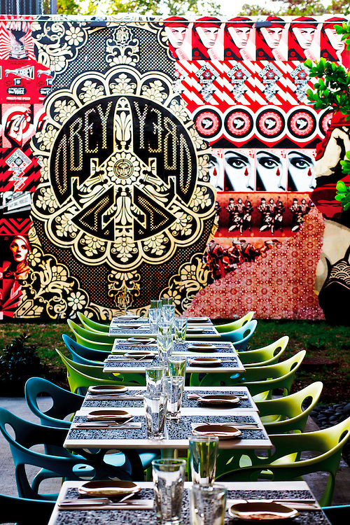 Mural by street artist Shepard Fairey at the Wynwood Kitchen and Bar restaurant in the popular Wynwood Walls complex founded by real estate visionary Tony Goldman.